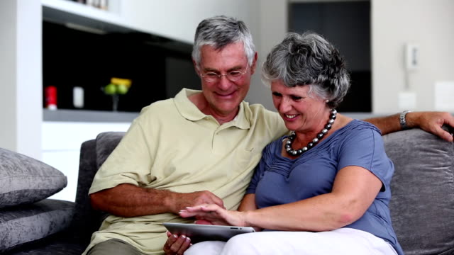 Mature couple using a tablet pc together video