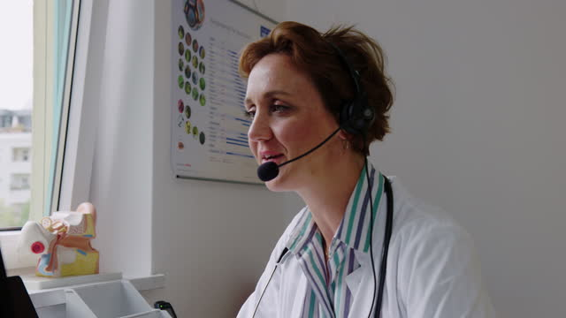 Mature doctor having a telemedicine video call