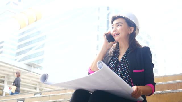 Mature engineers woman in urban with plan video