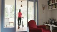 istock Mature Female Cyclist Preparing for Routine Ride 1302925671