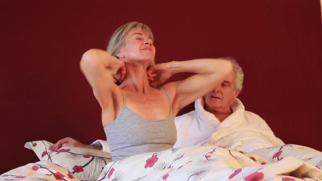 Mature female stretching in bed video