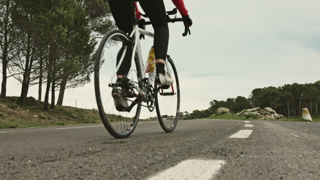 Mature Female Triathlete in Training on Racing Bicycle