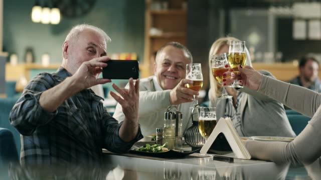 Mature friends taking selfie in restaurant video