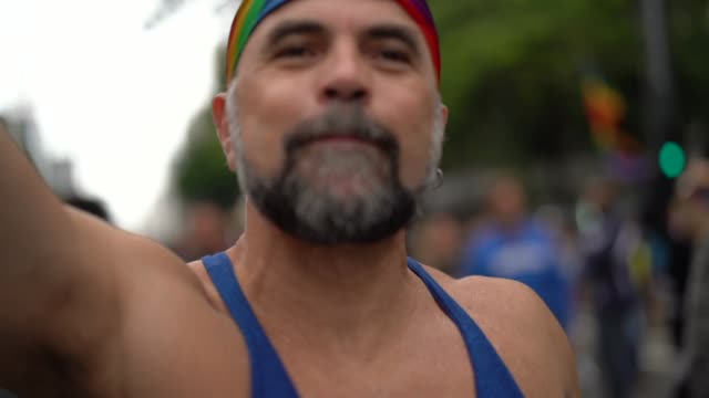 Mature Gay Man Dancing on Gay Parade Love is in the Air carnival celebration event stock videos & royalty-free footage
