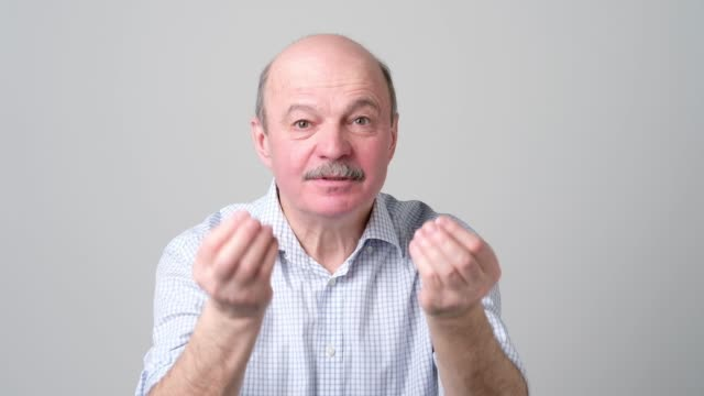 mature handsome man showing italian gesture that means what do you want - жестикулировать стоковые видео и кадры b-roll