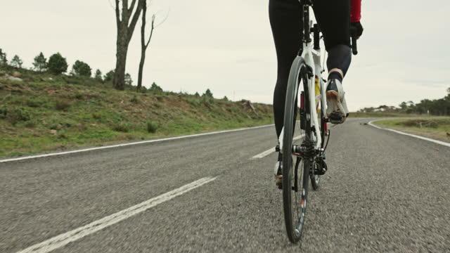 Mature Hispanic Female Triathlete Training on Racing Bicycle