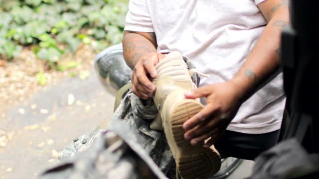 Mature Hispanic Veteran Putting on Prosthetic Limb A Mature Hispanic Veteran Putting on Prosthetic Limb amputee stock videos & royalty-free footage