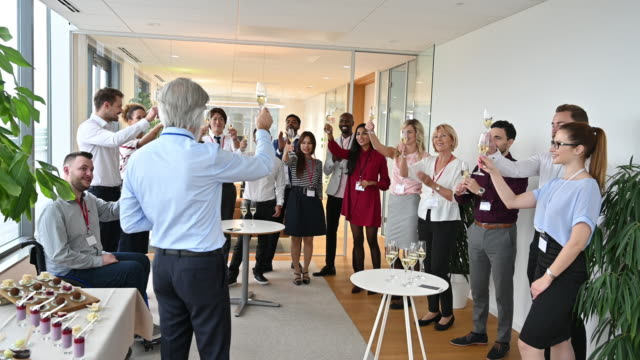 Mature male CEO making toast at new business launch party