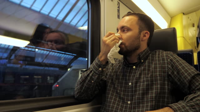 Mature man coughing in a train Medium shot.Mature man coughing in a train. Professional shot in 4K resolution. 02. You can use it e.g. in your commercial video, medical, business, presentation, broadcast coughing stock videos & royalty-free footage