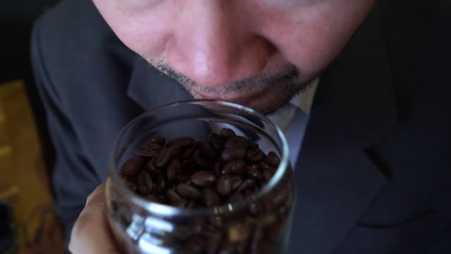 mature man expertise smelling roasted coffee beans