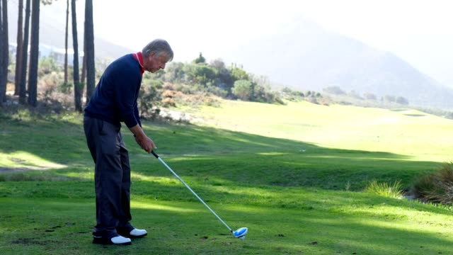 Mature man hitting a golf shot