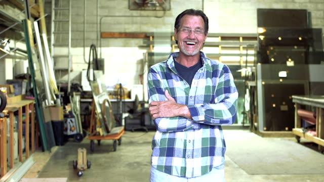Mature man in plate glass warehouse video