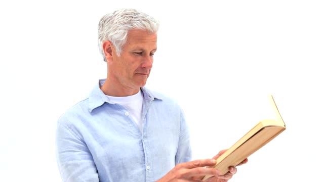 Mature man reading a book video