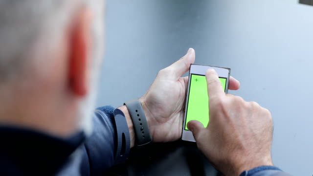 Mature Man Using Mobile Phone With Greenscreen video