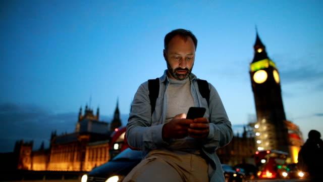 Mature man using phone in London video