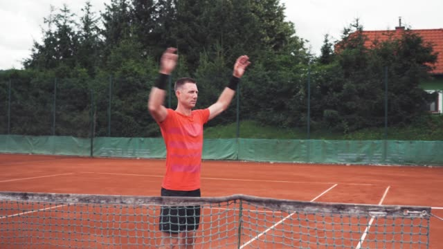 mature man warming up on a tennis court outdoors - target australia stock videos & royalty-free footage