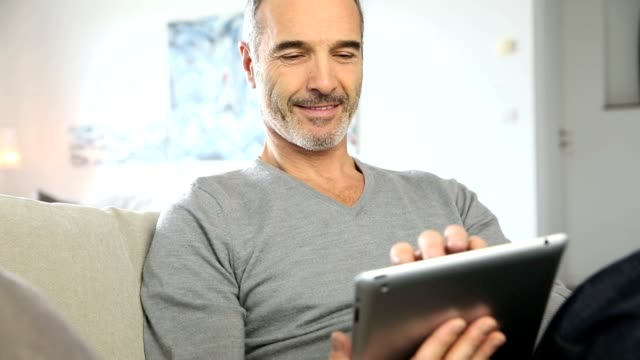 Mature man websurfing on internet video