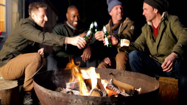 Mature Men Enjoying an Evening by the Fire video