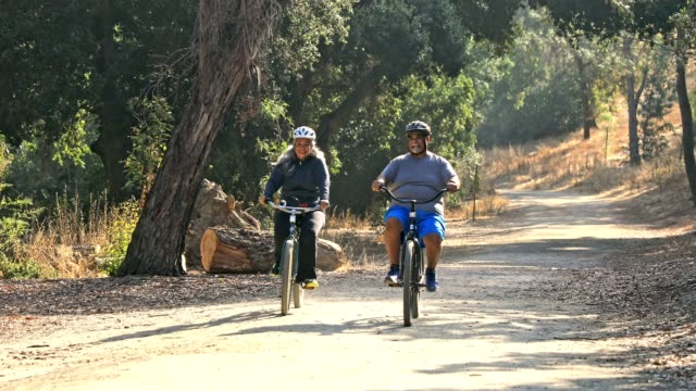 Mature Mexican Couple Bicycling