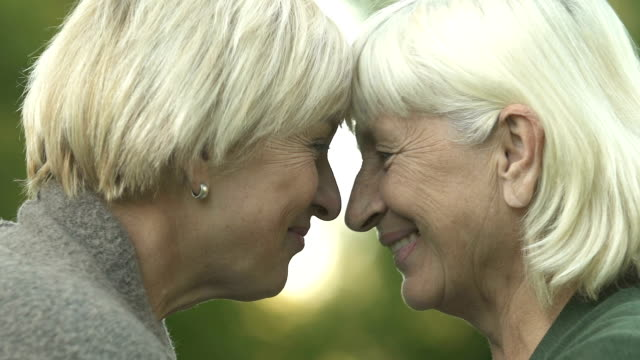 Mature mother and daughter touching heads, family relations, love and support Mature mother and daughter touching heads, family relations, love and support leaning stock videos & royalty-free footage