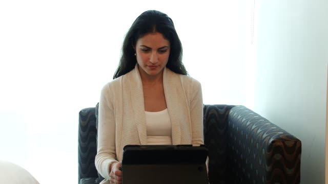 Mature multi ethnic business woman with tablet video