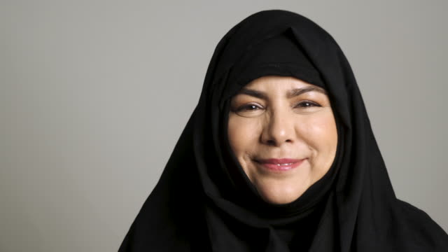 mature muslim woman looking at the camera