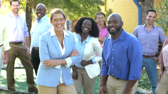 Mature woman, African-American man with business team