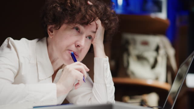 mature woman, an office employee, is sitting and thinking - eastern european descent stock videos & royalty-free footage