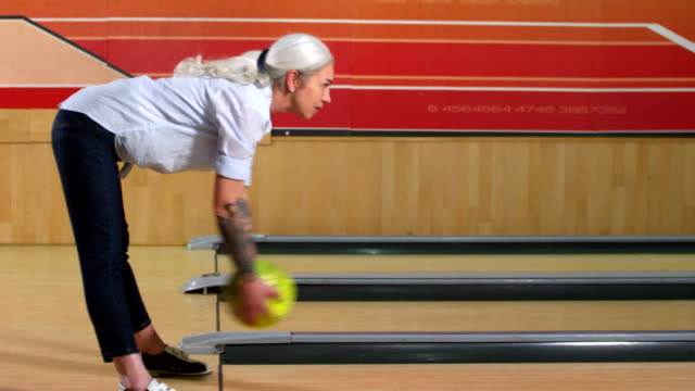 Mature Woman Bowling Between Legs