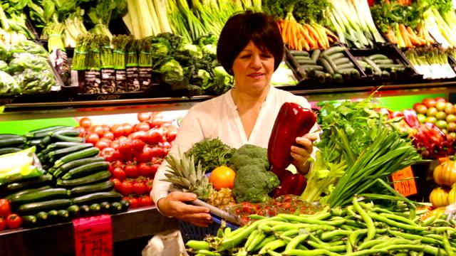 Mature woman choosing seasonal vegetables video