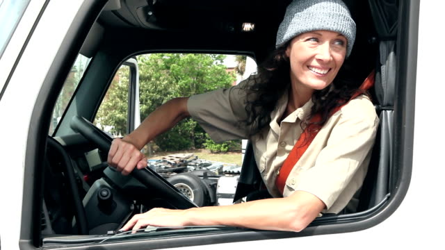 Mature woman driving semi-truck video