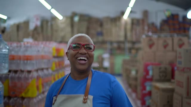 Mature woman employee dancing at wholesale