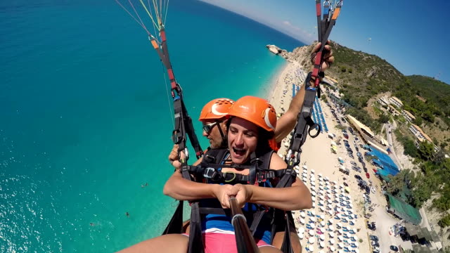 mature woman first time on paragliding.for excitement is never too late!! - vacanze video stock e b–roll
