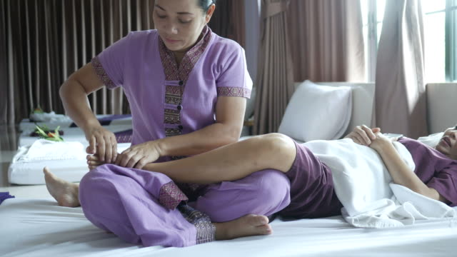 mature woman having relaxing  with thai massage - cultura tailandese video stock e b–roll