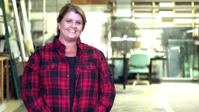 Mature woman in plate glass warehouse video