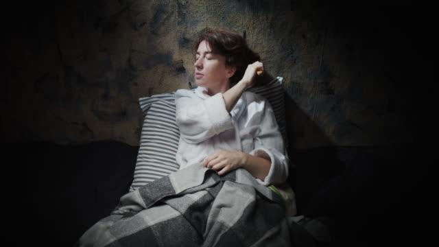 Mature woman is brushing her hair before sleep