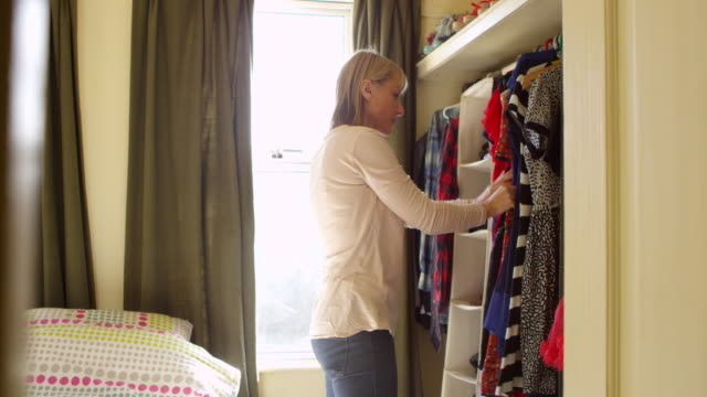 Mature Woman Looking Through Clothes In Wardrobe Shot On R3D video