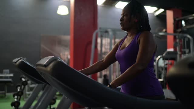 Mature woman on treadmill at the gym