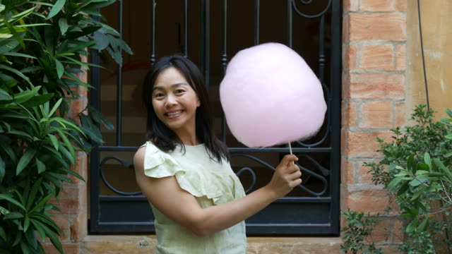 mature woman play peekaboo game with cotton candy video