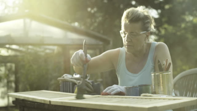 vídeos de stock e filmes b-roll de mature woman renovate old furniture - bricolage