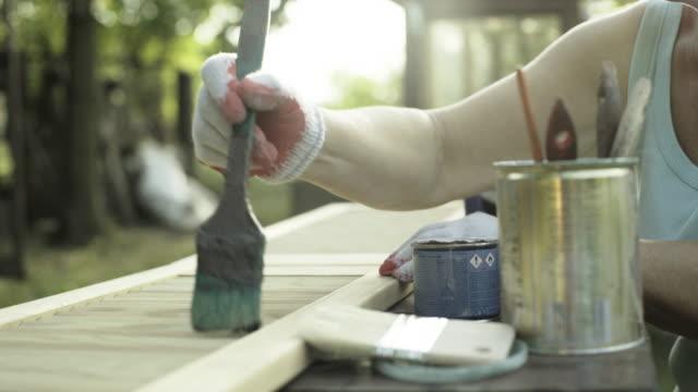 Mature woman renovate old furniture video