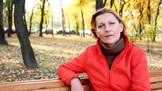 Mature woman resting Portrait mature woman resting on the park banch. 50 54 years stock videos & royalty-free footage