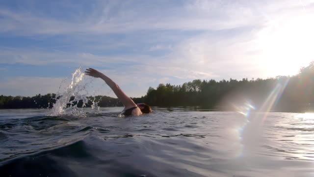 Mature Woman Swimming the Crawl in Lake