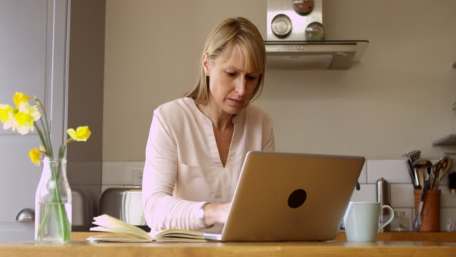 Mature Woman Using Laptop At Home Shot On R3D video