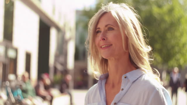 Mature woman walking confidently on a city street video