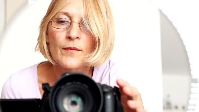 Mature woman with camera video