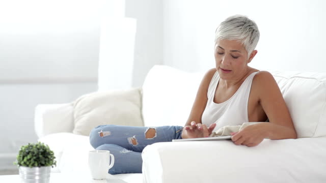 Mature woman with digital tablet video