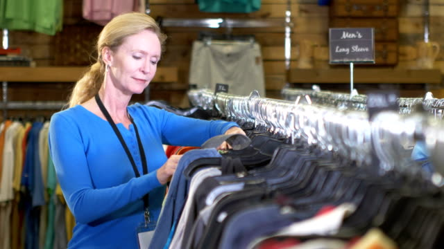 Mature woman working in clothing store video