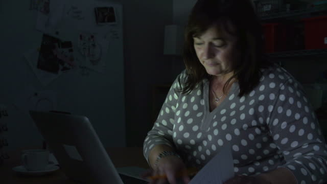 Mature Woman Working Late On Laptop In Office video