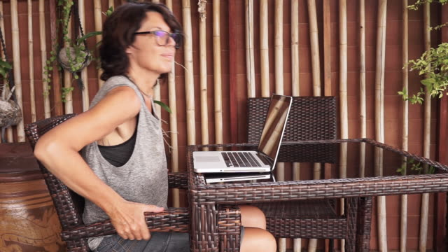Mature Woman working on computer from home